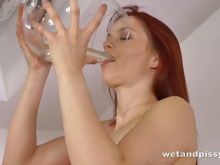 This gorgeous skanky redhead has a pee fetish and she is without exception pee thirsting