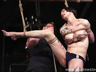 Tattooed suspension bondage of slave Reversa in caning