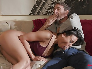 Luna Star plays approximately her tits while riding cock on the couch