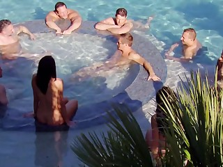 Couples surround each other in the hot tub
