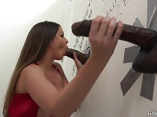 Brunette whore enjoying interracial glory hole fuck