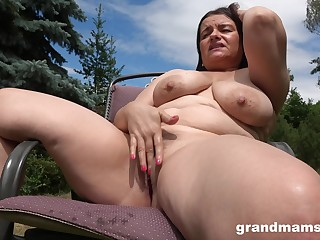 Horny milf masturbates in make an issue of garden guesstimate about hard penis