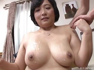 Toyokawa Mutsumi shows her massive tits to the camera for the artful time