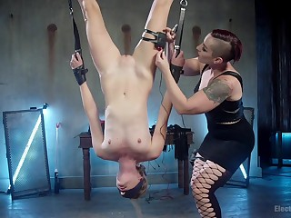 Submissive Mistress Kara enjoys lesbian games while she hangs tied