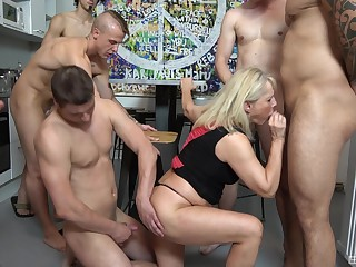 Gangbang crew with a mature addicted to dicks