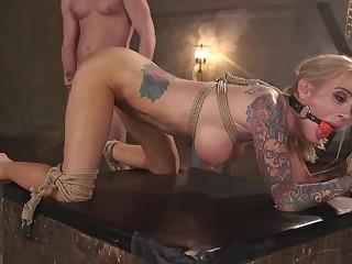 Tattooed blonde Sarah Jessie moans during hardcore agony