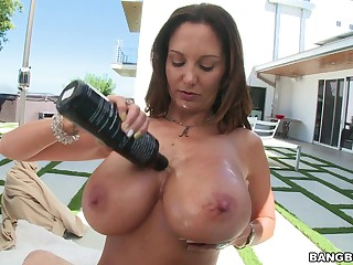 MILF Ava Addams lubes up her big juggs for POV titty job