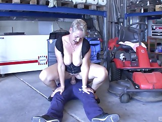 Worker with a large dick fucks his boss's wife on someone's skin floor